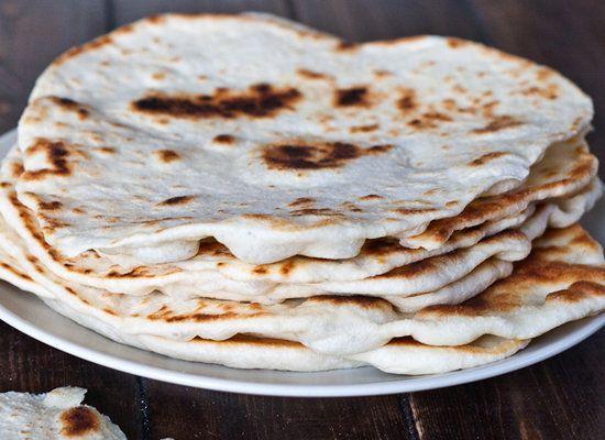 "<strong>Get the <a href=""http://www.jocooks.com/bakery/breads/naan/"">Naan</a> recipe from JoCooks</strong>"