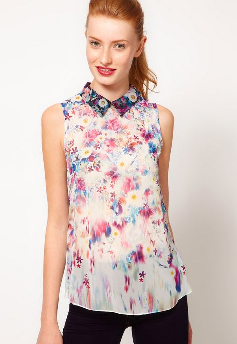 """<a href=""""http://us.asos.com/countryid/2/Warehouse-Floral-Print-Blouse/ym520/?iid=2417734&MID=35719&affid=2135&WT.tsrc=Affilia"""