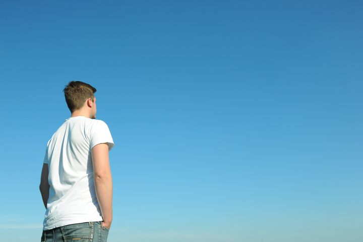 young man in white t shirt...
