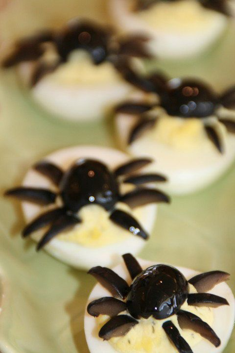 """<strong>Get the <a href=""""http://www.shockinglydelicious.com/halloween-deviled-spider-eggs/"""">Deviled Spider Eggs recipe</a> by"""