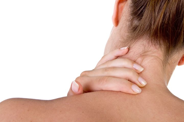 woman with pain in her neck and ...