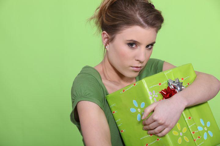 greedy woman hugging her...