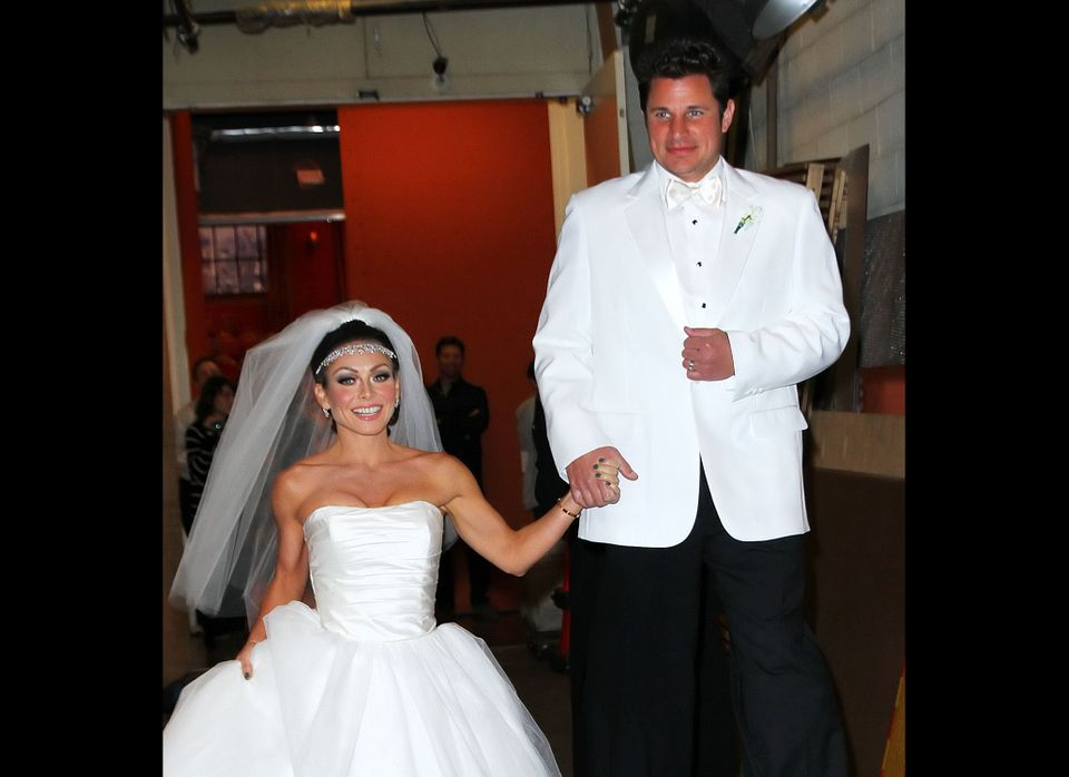 Kelly Ripa and Nick Lachey dress up as Kim Kardashian and Kris Humphries on their wedding day outside of Regis and Kelly show