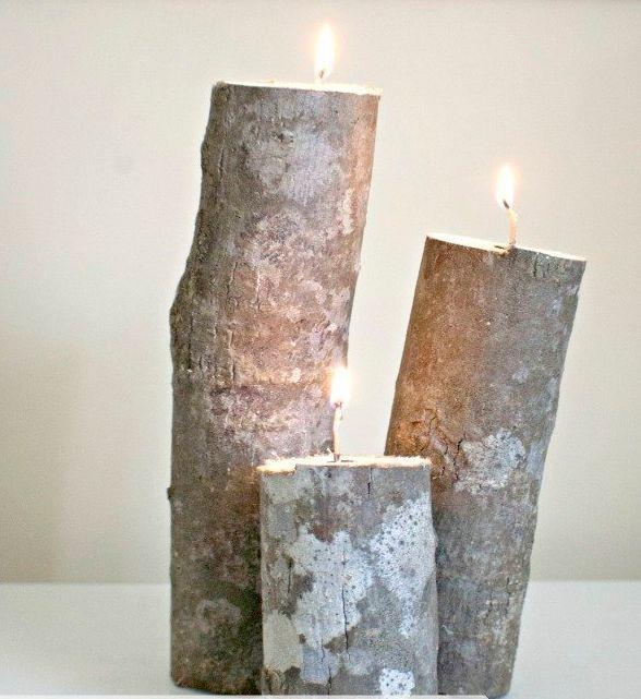 """(Photo by <a href=""""http://www.thehappierhomemaker.com/2012/10/tree-trunk-candle-holders.html"""">The Happier Homemaker</a>)"""
