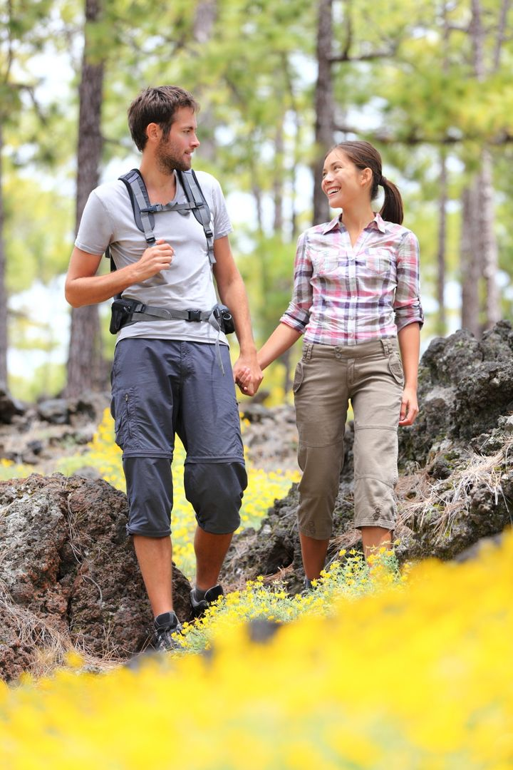 hiking couple walking in forest....