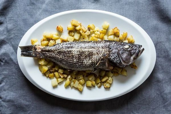 "<strong>Get the <a href=""http://food52.com/recipes/14570-whole-roasted-fish-with-rosemary-potatoes"" target=""_blank"">Whole Roa"