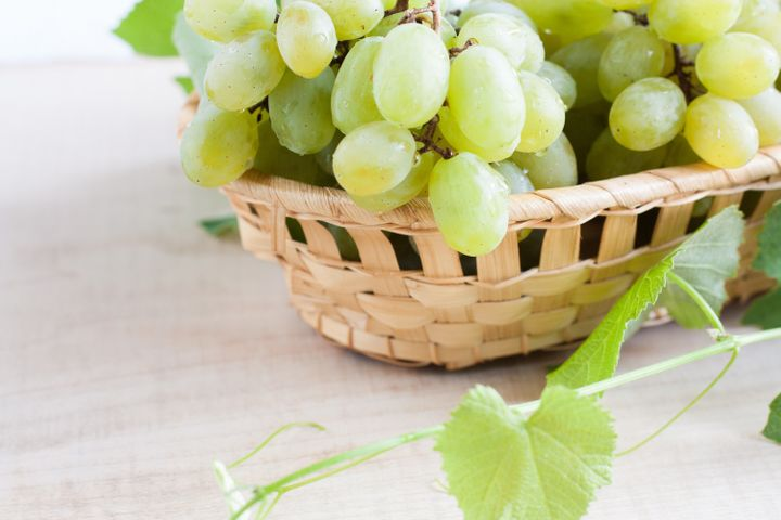 grapes in a wooden basket....