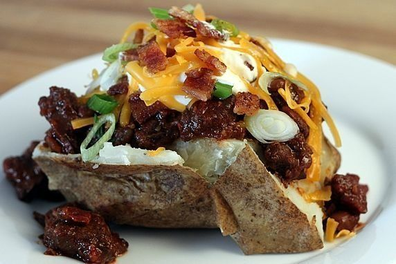 """<strong>Get the <a href=""""http://www.theyummylife.com/baked_potato_bar"""">Loaded Baked Potato recipe from The Yummy Life</a></st"""