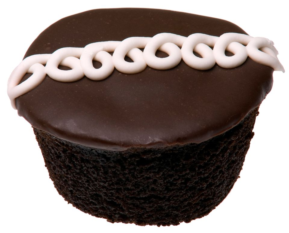 Hostess Cupcakes are chocolate cakes with chocolate icing and vanilla cream filling.
