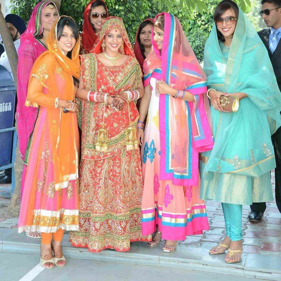 """""""Here's one from an Indian wedding! The bride is my sister-in-law in red and I'm the one in turquoise extreme right."""" Submitt"""