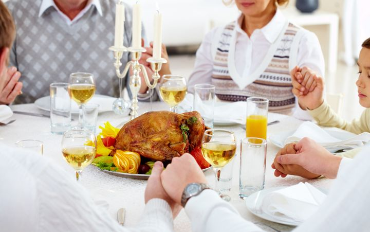 family members giving thanks to ...