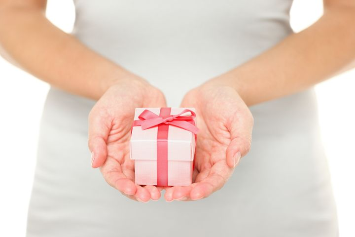 hands holding gift   present in ...