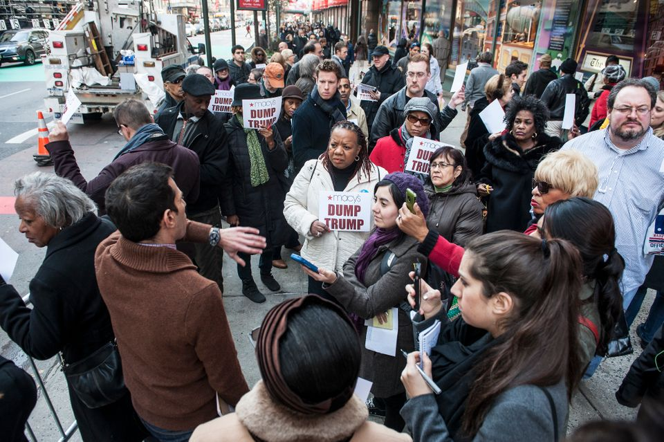 "Angelo Carusone speaks to protesters at the ""Dump Trump"" protest he organized at Macy's Herald Square store in New York Tuesd"