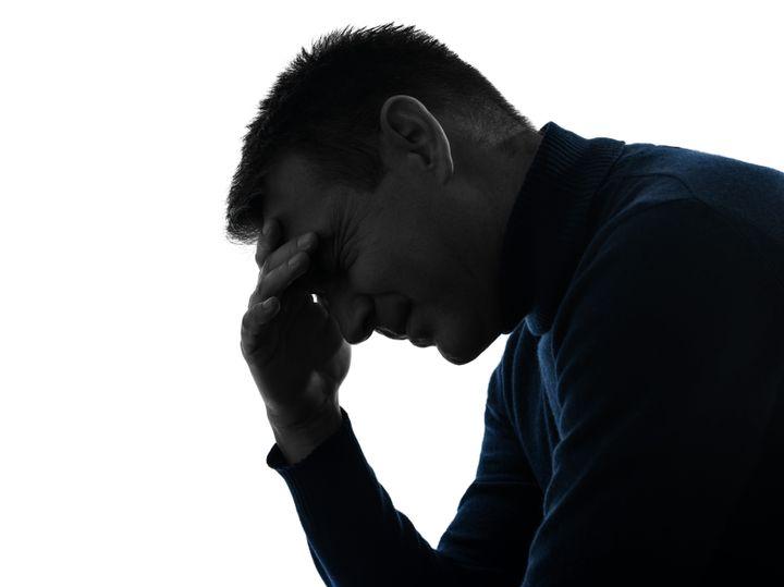 one causasian man headache pain ...