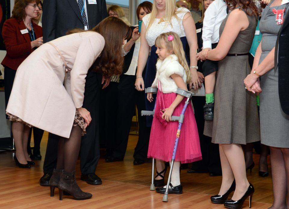 The Duchess of Cambridge meets Emma Henson, 7, during a visit to Peterborough City Hospital in Cambridgeshire, as part of an