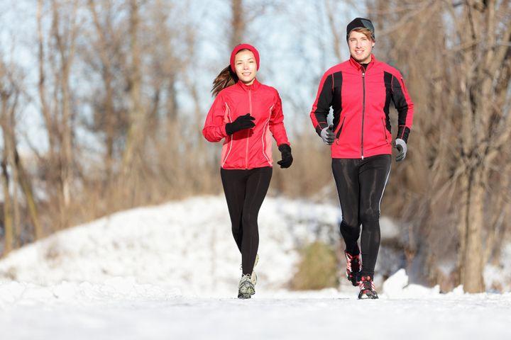 sport couple running in winter. ...