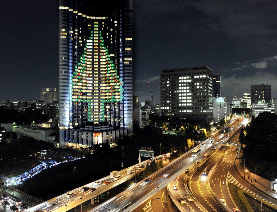 Illuminated from the wall of Tokyo's Akasaka Grand Prince hotel.   (AFP)