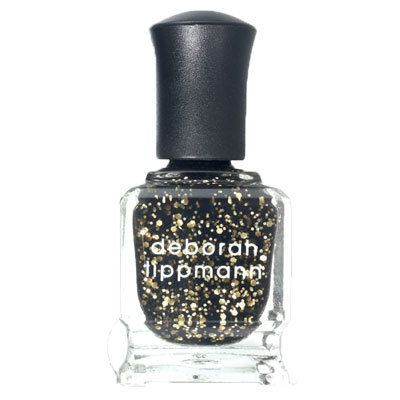 """Flecked with gold and black glitter, this polish is the perfect accessory for New Year's Eve.  At <a href=""""http://lippmanncol"""