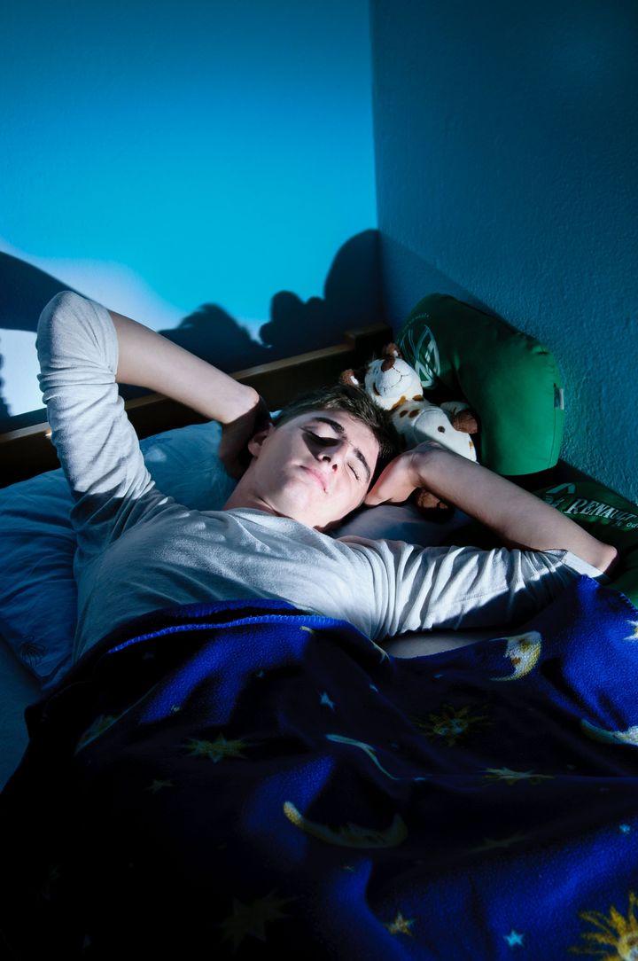 boy relaxing in bed
