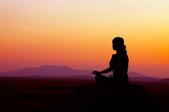 silhouette of a beautiful yoga...