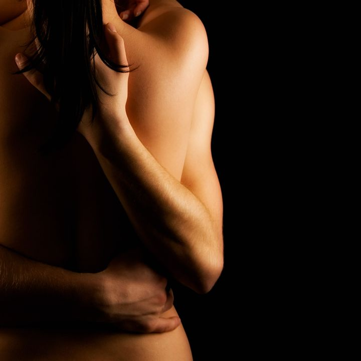 Hands hugging a girl in passion
