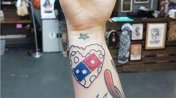 러시아에서 도미노피자 로고 문신을 새기면 100년간 피자가