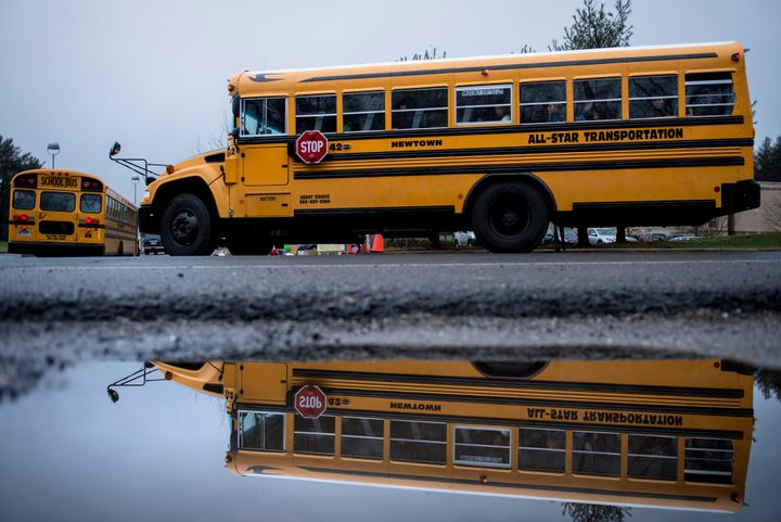 A school bus takes students to Newtown High School December 18, 2012 in Newtown, Connecticut. Students in Newtown, excluding