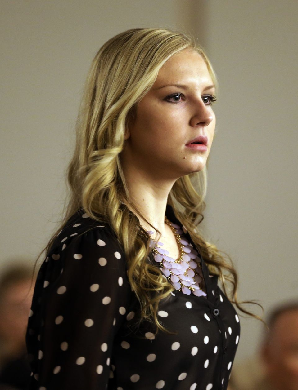 Kendra Gill, former Miss Riverton, looks on before her court appearance in District Court Thursday, Sept. 26, 2013, in Salt L