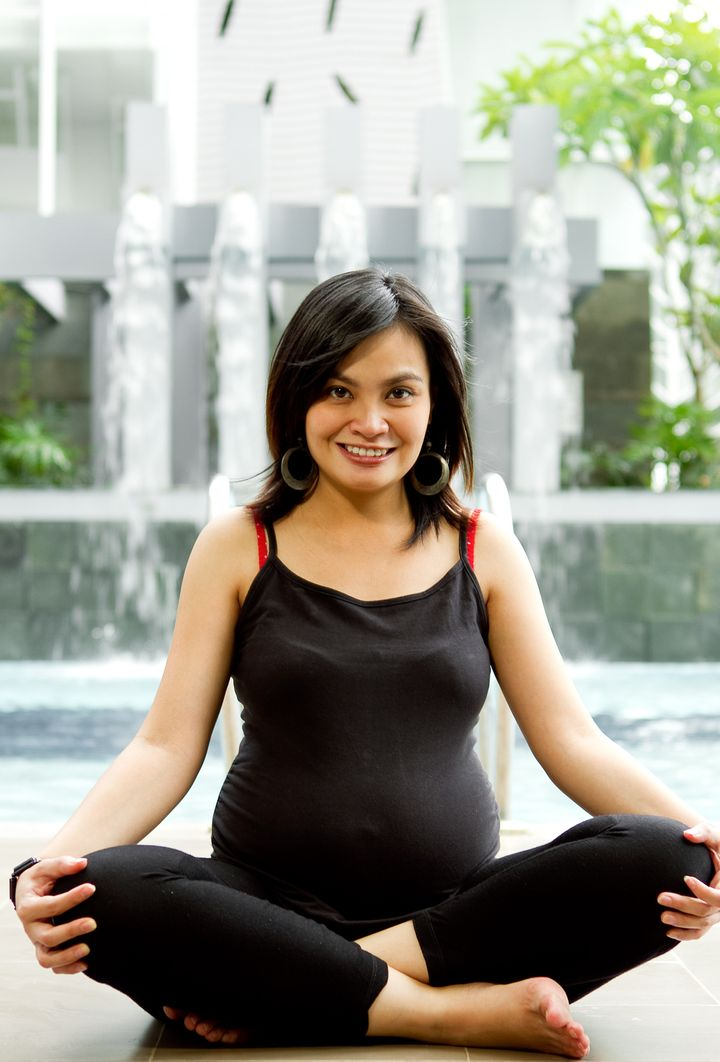Asian ethnic pregnant woman exercise by the pool