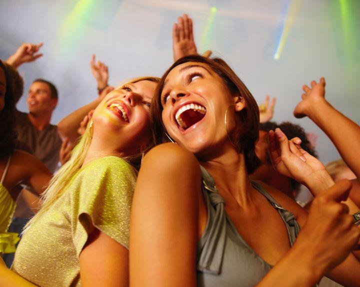 Closeup of laughing young girls enjoying at nightclub