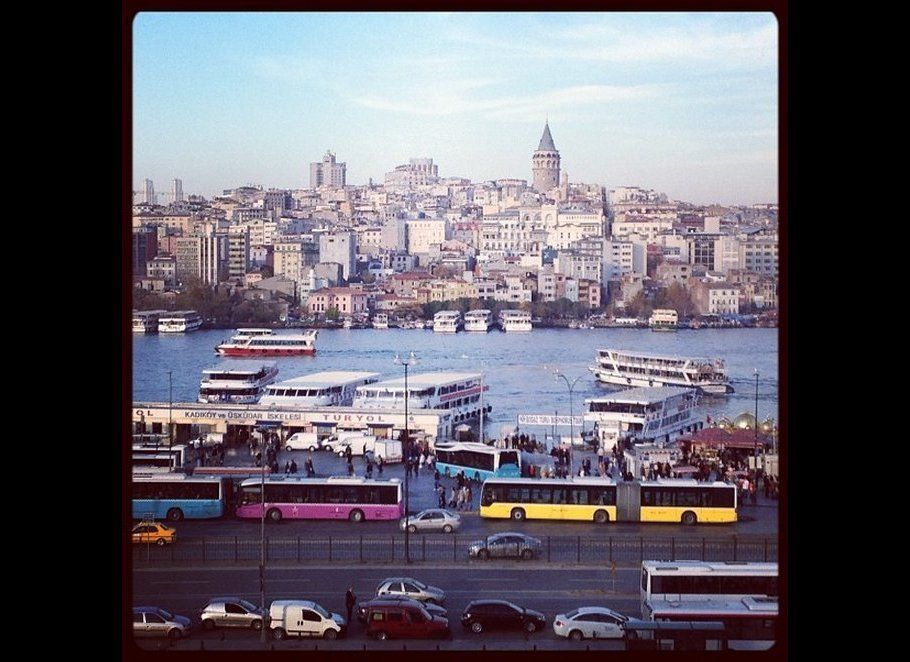 Istanbul waterscape complimented by multicolored pop art buses.