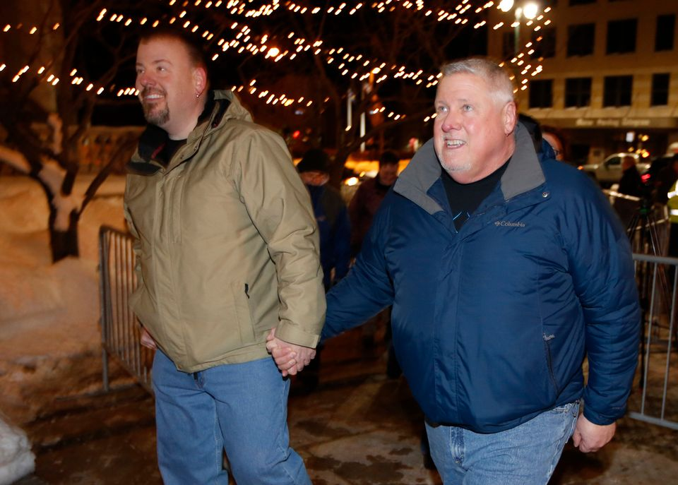 Steven Bridges, left, and Michael Snell, a couple for nine years, arrive at City Hall in Portland, Maine.
