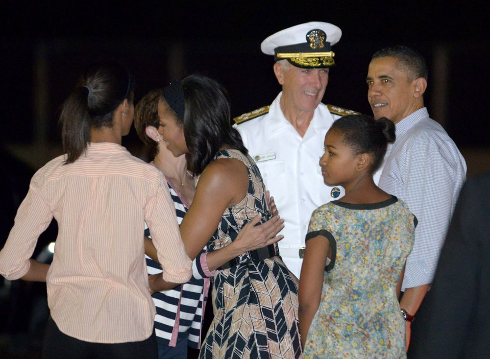 US President Barack Obama, First Lady Michelle Obama and disembarks Obama Air Force One with daughters Natasha and Malia at J
