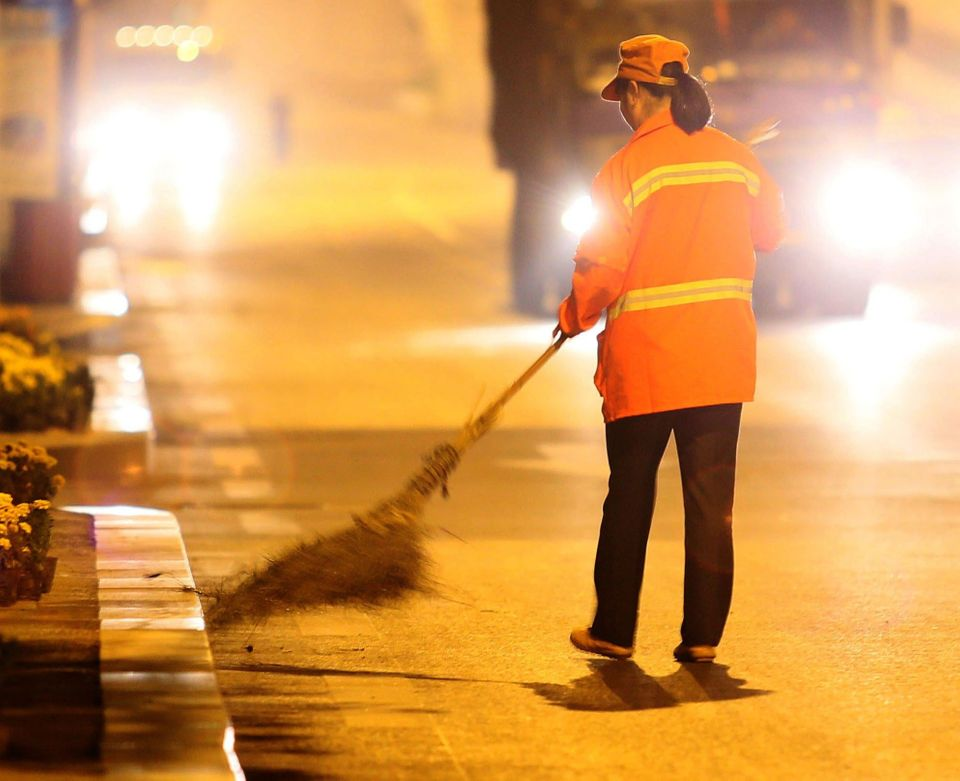 53-year-old Chinese real estate mogul Yu Youzhen works as a street cleaner on October 13, 2012 in Wuhan, Hubei Province of C