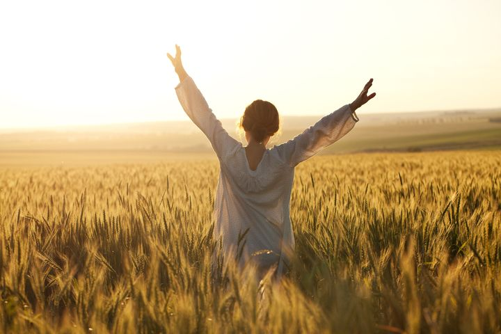 woman with arms outstretched in ...