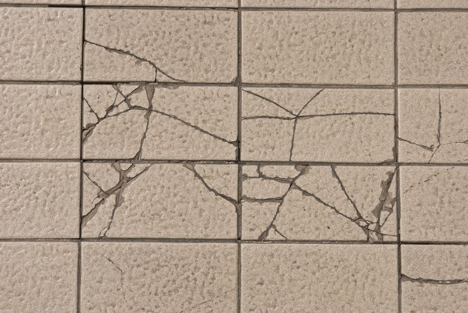 To fix a broken floor tile, you will need a replacement tile, tile adhesive and latex-fortified grout. If you do not have an