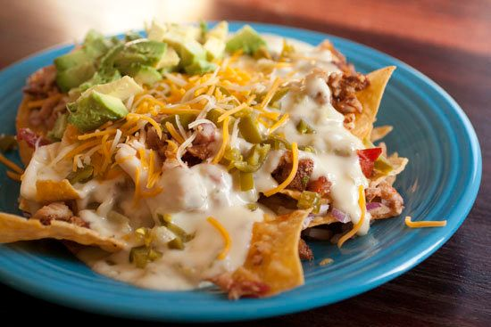 "<strong>Get the <a href=""http://www.macheesmo.com/2012/05/rib-nachos/"">Baby Back Rib Nachos recipe from Macheesmo</a></strong"