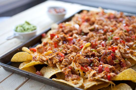 "<strong>Get the <a href=""http://www.macheesmo.com/2012/10/chicken-fajita-nachos/"">Chicken Fajita Nachos recipe from Macheesmo"