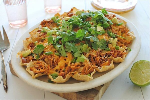 "<strong>Get the <a href=""http://bevcooks.com/2012/12/slow-cooker-chicken-nachos/"">Slow Cooker Chicken Nachos recipe from Bev"