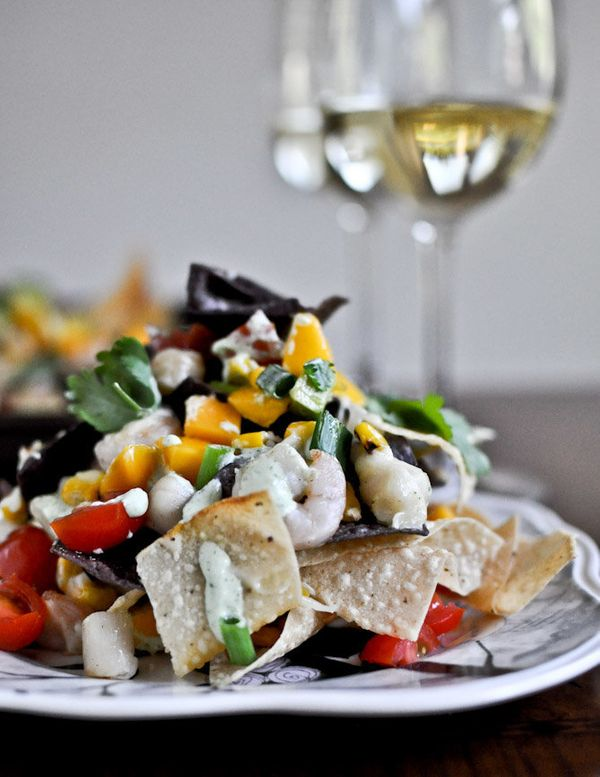 """<strong>Get the <a href=""""http://www.howsweeteats.com/2012/07/summertime-seafood-nachos-with-grilled-corn-avocado-cream/"""">Summ"""