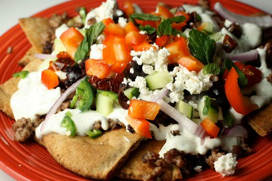 "<strong>Get the <a href=""http://www.macheesmo.com/2010/01/greek-nachos/"">Greek Nachos recipe from Macheesmo</a></strong>"