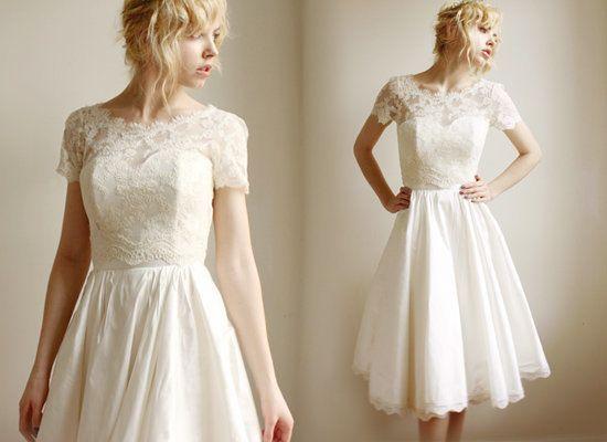 "Gown by <a href=""http://www.etsy.com/listing/99470716/elandra-2-piece-lace-and-silk-wedding"">Leanimal</a>."