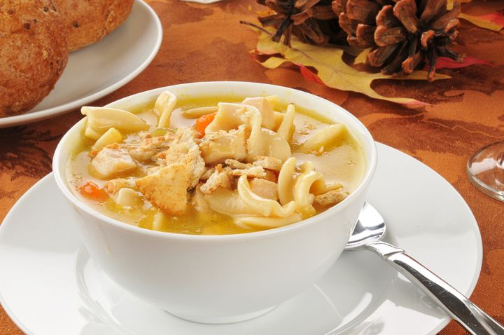 a bowl of turkey noodle soup on ...