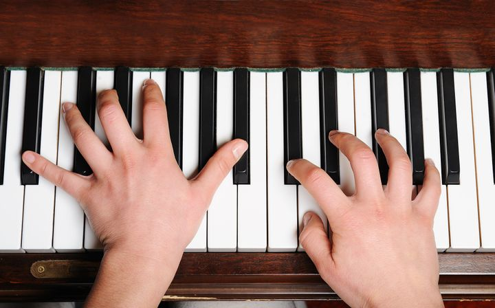 the hands of a pianist in...