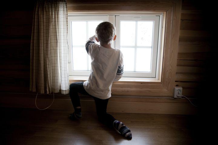 Boy looking at window