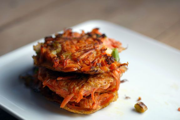 "<strong>Get the <a href=""http://food52.com/recipes/8045-carrot-scallion-latkes"" target=""_blank"">Carrot Scallion Latkes recipe"