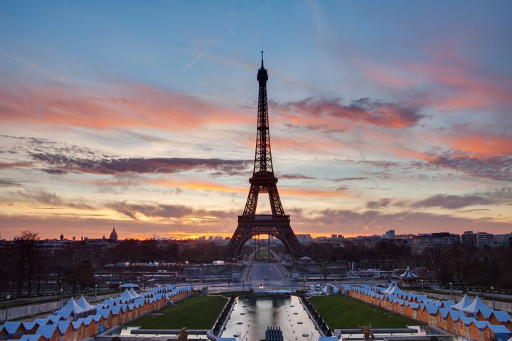 eiffel tower with red clouds...
