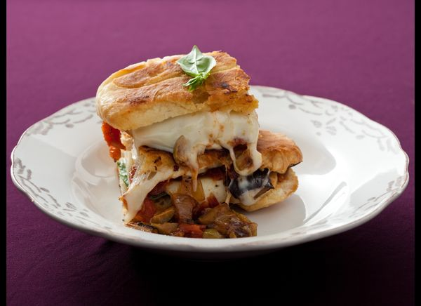 """<strong>Get the <a href=""""http://www.huffingtonpost.com/2011/10/27/caponata-mozzarella-and_n_1057250.html"""" target=""""_hplink"""">Ca"""