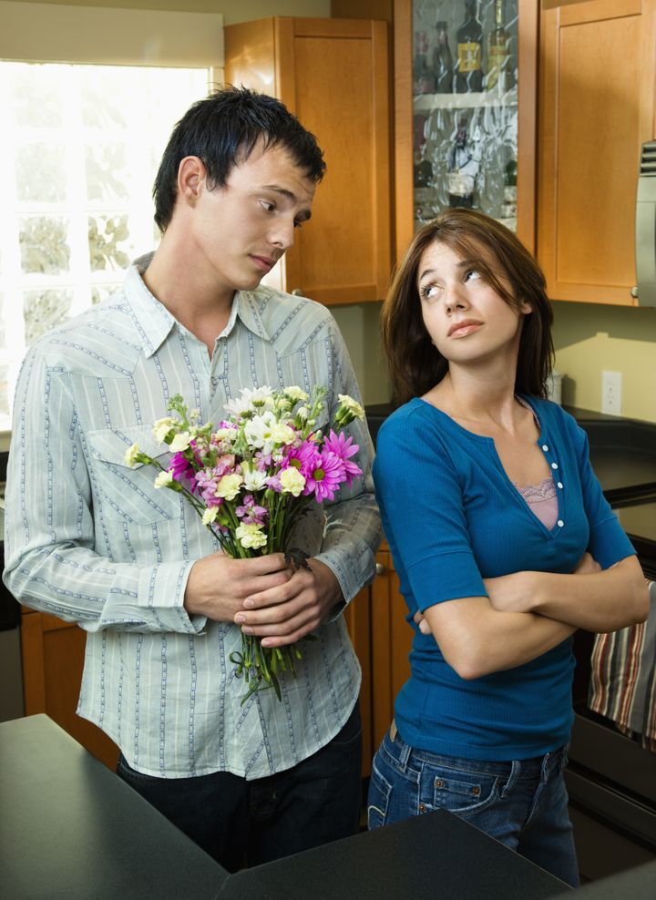 Husband trying to give wife flowers and getting the cold shoulder.