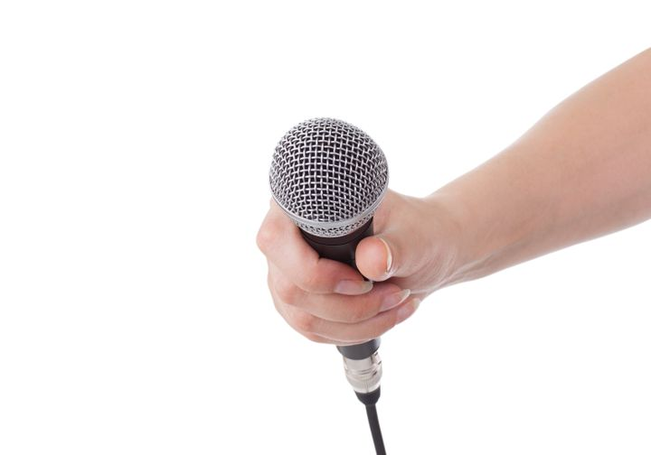 microphone in hand isolated on...